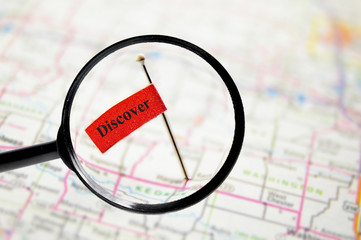 pin with Discover flag and magnifying glass