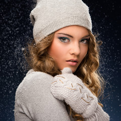 Girl in winter clothes during a snowfall