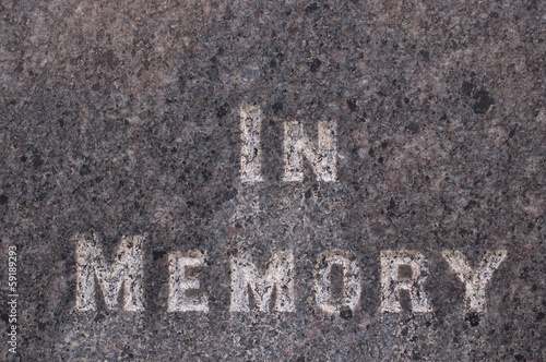 """In memory"" words inscribed on a gravestone"