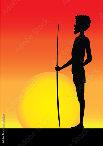 silhouette of aborigine man in the sunset