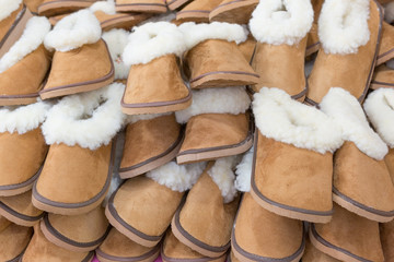 Large group of warm soft slippers for the winter. Close-up.