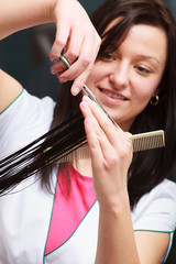 Hairstylist cutting hair woman client hairdressing beauty salon
