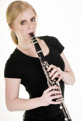 Pretty Blond Woman Playing Clarinet Musical Performance White