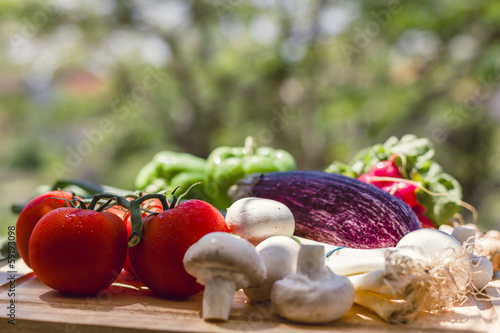 Fresh vegetables on wooden chopping board