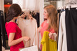 Two Women shopping choosing dresses