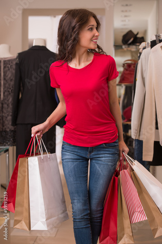 Beautiful Woman with Shopping Bags in Shopping Mall