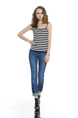 Pretty young woman in Striped shirt looking away. posing