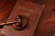 Justice gavel on leather Contract Law book