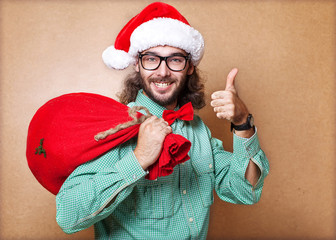 Hipster Santa Claus with the bag of the presents shows class