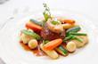Tenderloin steak with vegetables and bone marrow