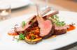 Leinwandbild Motiv Grilled rack of lamb with vegetables