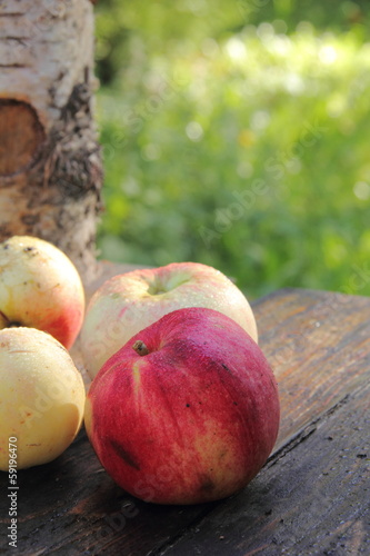 Apples. Wooden table.