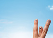 Happy smiley fingers looking at clear blue sky copyspace