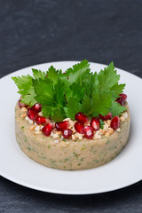 white bean pate with nuts and pomegranate seeds, vertical
