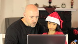 Dad And Daughter Shop Online For Christmas Gifts