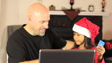 Daughter Does Online Christmas Shopping For Mommy
