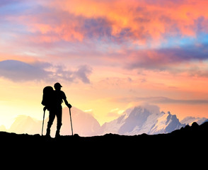 Silhouette of a winner on the mountain top.
