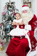 little girl sits on a lap at Saint Nicolas