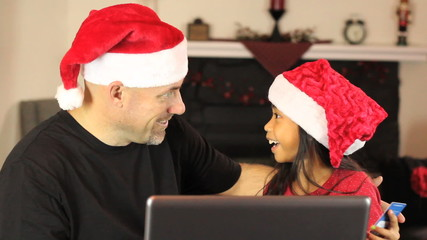 Father And Daughter Buying Christmas Gifts Online