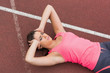 Sporty woman suffering from headache on the running track