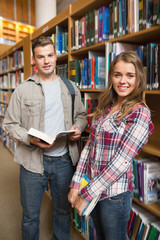 Classmates standing in library smiling at camera