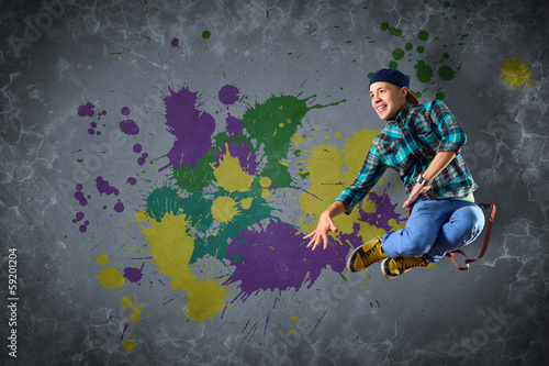 male dancer with splashes of paint