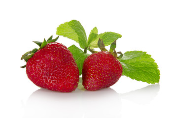 Fresh fragrant strawberry and the spearmint leaves