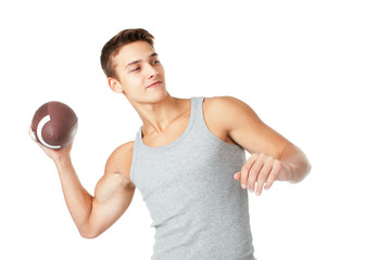 Young man throwing the rugby ball