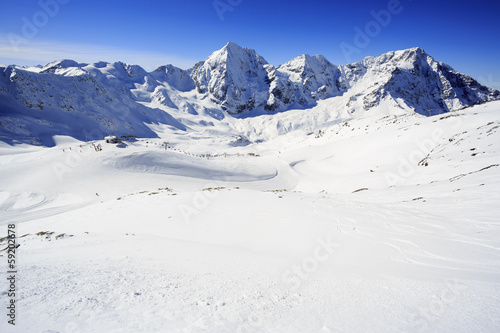 Winter mountains - ski slopes in Italian Alps