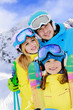 Ski and fun - family enjoying winter holiday