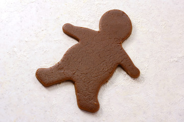 Gingerbread man shape in cookie dough