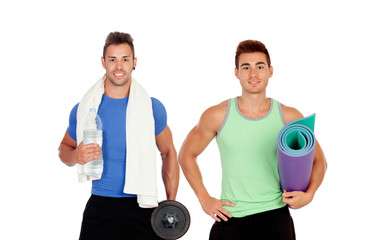 Two muscular men with gym equipment