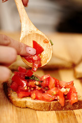 Making of tomato bruschettas