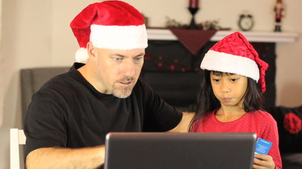 Santa And Elf Buying Christmas Gifts Online