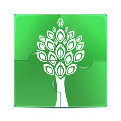 eco icon.green puzzle with the image of a white tree.puzzles wit