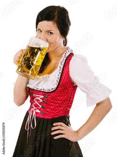 Woman wearing dirndl and drinking Oktoberfest  beer