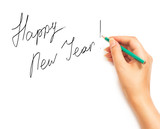 Woman's hand holding a pencil and writing Happy New Year on a wh