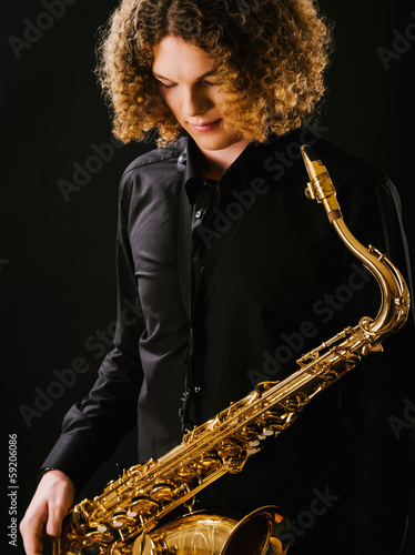 Young man and his saxophone