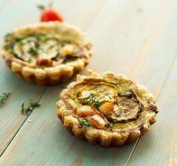 Quiche with grilled zucchini smoked cheese and herbs