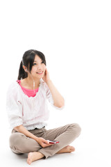 young asian woman listening to music on white background