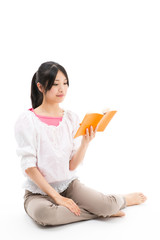 young asian woman reading book on white background