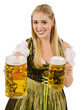 Happy blond serving beer during Oktoberfest