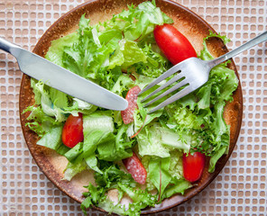 green salad with smoked sausage