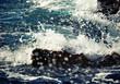Stone breakwater with breaking waves. Adriatic Sea.