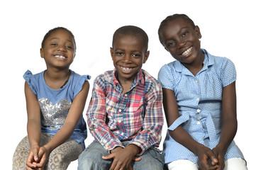 Drei afrikanische Kinder laecheln