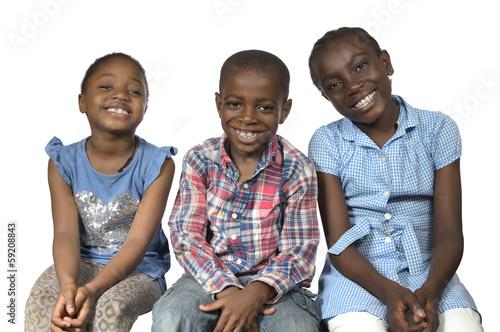 canvas print picture Drei afrikanische Kinder laecheln