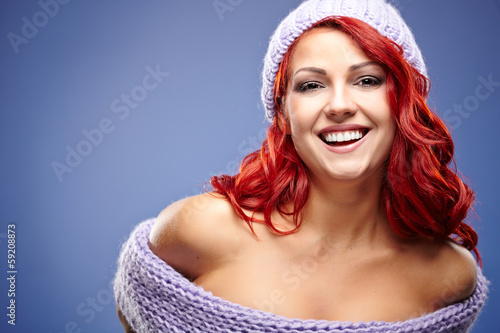 portrait of beautiful woman redhair on blue