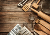 Rural kitchen utensils on vintage planked wood table