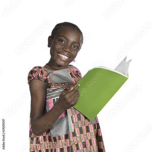 canvas print picture Afrikanisches Maedchen mit Schulbuch