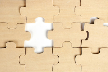 close up of the pieces of a  wooden puzzle